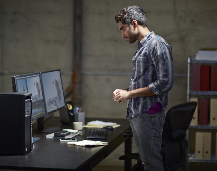 Man looking over a media project using HP Z27i Displays and HP Z440 Workstation.
