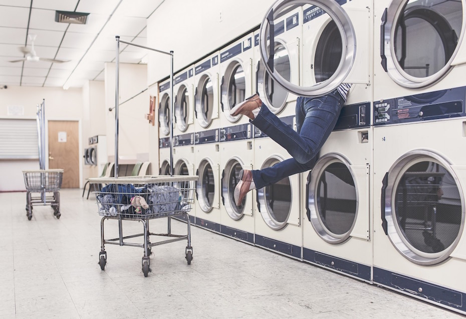 laundry-with-washing-machines-and-housewifes-legs-1