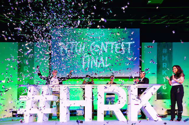 Silver confetti rains down on startup founders during the pitch contest at the 2016 Heureka conference.